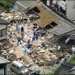 Days after twin tragedies, Japan begins to dig for dead