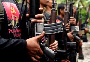 Members of the New Peoples Army (NPA) belonging to the Pulang Bagani Command celebrate the 40th Founding Anniversary of the Communist Party of the Philippines (CPP) somewhere in Davao City on Friday,  December 26, 2008. The NPA, which is the armed wing of the CPP, has been fighting for the establishment of the Marxist state in the Philippines since 1968. AKP Images/ Keith Bacongco