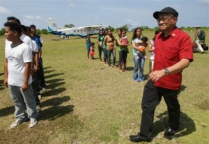 Philippine Congressman Walden Bello, right, walks past local residents and municipal employees of Pagasa Island, part of the disputed Spratly group of islands, in the South China Sea located off the coast of western Philippines Wednesday, July 20, 2011. China protested a trip made by Filipino lawmakers to disputed areas in the South China Sea to assert the claim of the Philippines. Ethan Sun, spokesman for the Chinese embassy in Manila, said the trip scheduled was 'against the spirit' of a code of conduct signed by claimants to the areas in 2002. The Spratlys, believed to be rich in oil, mineral and marine resources, are also claimed in whole or partly by Brunei, Malaysia, Vietnam and Taiwan.   (AP Photo/Rolex Dela Pena, Pool)
