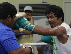 Philippine boxing icon Manny Pacquiao began training Wednesday for his June world title defence against US challenger Timothy Bradley, saying he has God in his corner. Pacquiao is regarded as one of the best 10 southpaws in boxing history.