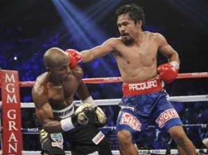 Manny Pacquiao connects with a right to the head of Timothy Bradley in their WBO world welterweight title fight Saturday, June 9, 2012 at the MGM Grand Garden Arena in Las Vegas. Pacquiao landed more power punches and appeared to have won most of the 12-round fight.(MNS Photo)
