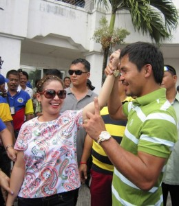 Filipino boxer and incumbent Congressman Manny Pacquiao, right, raises the hand of his wife Jinkee shortly after filing their respective Certificates of Candidacy (COC) for next year's midterm elections at the local Commission on Elections office in Alabel township, Sarangani province in southern Philippines Tuesday Oct. 2, 2012. Pacquiao is seeking reelection for his province's lone congressional district while his wife is running for vice-governor of the province. Pacquiao's younger brother and a sister-in-law have also entered politics and are running as Congressman in another province and as a village chief respectively. (MNS photo)