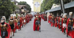 """Penitents, locally known as """"Morions"""", wear masks and Roman centurion costumes as they take part in a procession commemorating the passion of Christ during Holy Week at Mogpog town in Marinduque, central Philippines, March 25, 2013. (MNS photo)"""