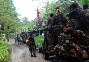 "A Facebook page that carried the name of Nur Misuari, the leader of the Moro National Liberation Front that waged a secessionist war against the Philippine government during the time of the late dictator Ferdinand Marcos in the 70s, posted this photo apparently comprising  of former MNLF soldiers being portrayed as on their way to Sabah ""to help their fellow Muslims"" the Tausugs. A note on the page says: ""This page is approved but not directly manage by Prof. Misuari – Professor Dr. Nur P. Misuari, MNLF founding leader & Central Committee chairman; UN Peace Awardee; Nobel Peace Laureate Nominee. The standoff in Sabah has killed at least 60 people, according to reports."