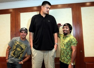 Brandon Rios (left) and Manny Pacquiao meet a Sentinel. (Chris Farina/Top Rank)