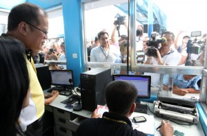 """President Benigno S. Aquino III listens to the briefing on the status of the volume of passengers by SWIPTS terminal manager Dir. Amante Salvador during the inspection on the security arrangements and facilities at the Southwest Integrated Provincial Transport System (SWIPTS) departure area at the Uniwide Coastal Mall in Baclaran, Parañaque City on Thursday (October 31, 2013) to ensure the safety of the passengers for the observance of the All Saints' and All Souls' Day during the Visit to Major Terminals in Metro Manila for DOTC's Undas 2013 """"Oplan Ligtas Biyahe"""". (MNS photo)"""