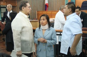 Former Philippine President Gloria Macapagal Arroyo, now a sitting lawmaker in the lower house of Congress, is flanked by husband Jose Miguel Arroyo (L) and her son Congressman Juan Miguel Arroyo inside  the Sandiganbayan anti-graft court in Quezon City, Metro Manila, April 11, 2012. Arroyo  entered a plead of not guilty before an anti-corruption court for her role in an aborted $329 million broadband deal with China's ZTE Corp in 2007 after a congressional inquiry in 2008 showed she allegedly did not stop her allies from collecting huge pay offs for the deal. Arroyo's husband, a former communications minister and the former head of the country's elections agency are facing similar corruption charges. REUTERS/Renz Joshua Posedio/ Philippine National Police-Public Information Office/Handout   (PHILIPPINES  - Tags: POLITICS CRIME LAW) FOR EDITORIAL USE ONLY. NOT FOR SALE FOR MARKETING OR ADVERTISING CAMPAIGNS. THIS IMAGE HAS BEEN SUPPLIED BY A THIRD PARTY. IT IS DISTRIBUTED, EXACTLY AS RECEIVED BY REUTERS, AS A SERVICE TO CLIENTS