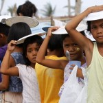 Haiyan student victims start school in steamy tents