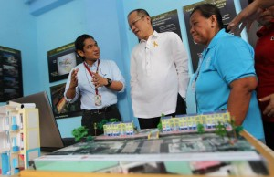 President Benigno S. Aquino III graces the Presentation of Estero de San Miguel Micro Medium-Rise Building (mMRB) Model Unit at the Claro M. Recto High School Auditorium in Barangay 412, Zone 42, Legarda Street, Sampaloc, Manila City on Wednesday (February 19, 2014). The Estero de San Miguel Project is in line with the program goal of providing safe, affordable, decent and humane relocation in accordance with the Relocation Action Plan (RAP) through the People's Plan mechanism and process for on-site, near-city relocation of affected ISFs in accordance with People's Plan that contains shelter solutions and finance scheme development, validated and accepted by the ISFs themselves. The MRB model unit started construction in November 2013 and was completed in January 2014.  (MNS photo)