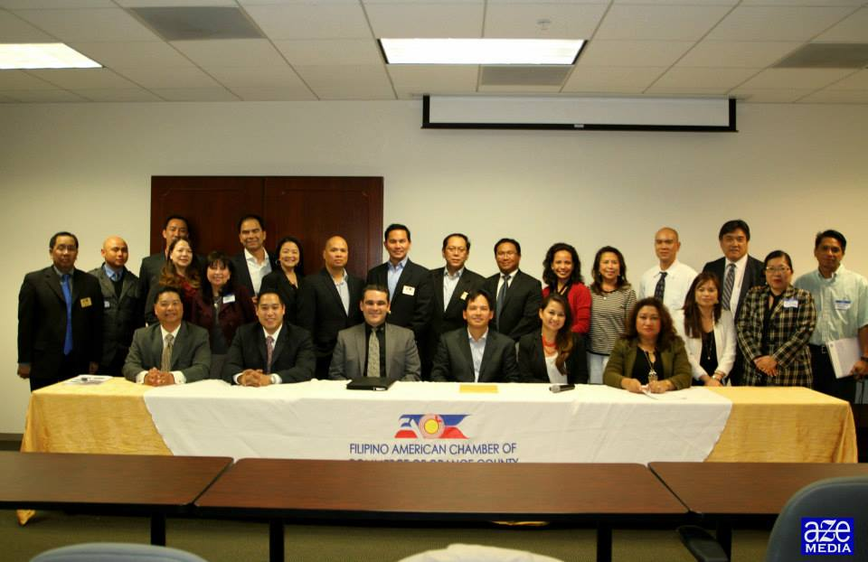 FACCOC EQUIPS FOR 2014: The Filipino American Chamber of Commerce of Orange County retools its members for the expected economic rebound with a seminar to help the members navigate Orange County's business route. The members and officers of the organization take a brief time out from their Feb. 19th event at the New York Life building in Irvine City. (photo courtesy of FACCOC facebook page)