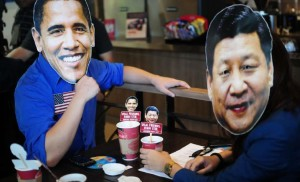 """Youth members of Akbayan Partylist wearing masks of US Pres. Barrack Obama and Chinese President Xi Jinping  """"occupied"""" a coffee shop in Quezon City to draw attention to the """"occupationist ambitions"""" of both the United States and China. The group is opposing the US military's enhanced defense cooperation with the Philippines and China's continuing incursions in the West Philippine Sea."""