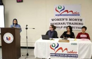Acting Head of Post Imelda Panolong addressing the audience and seated (L-R) Grants and Communications Manager Jessy Needham, MOTHER, President Rosemarie Mejia and MOTHER, Founder Perla Reyes.