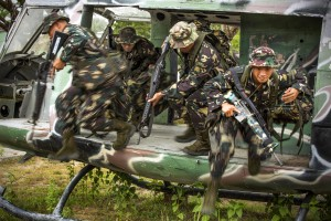 Philippines Army Soldiers exit a grounded training helicopter during helicopter insert and extract training with U.S. Army Soldiers on Fort Magsaysay, Philippines, April 29, 2014. Philippine and U.S. Army personnel are preparing for an upcoming field training exercise during Balikatan 2014. This year marks the 30th iteration of the exercise, which is an annual Republic of the Philippines-U.S. military bilateral training exercise and humanitarian civic assistance engagement. (U.S. Marine Corps photo by Staff Sgt. Pete Thibodeau/Released)