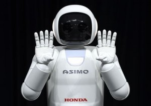 Honda North America shows off their new Asimo Robot Honda's ASIMO was introduced to much fanfare in 2000 as a multi-functional mobile assistant which resembles a shrunken spaceman. ©AFP PHOTO / Timothy A. CLARY