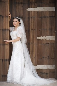 Jannelle So Wedding gown by Carlyn Nuyda-Calloway of Thumbelina Atelier Mr. & Mrs. Perkins' Wedding by KLK Photography)
