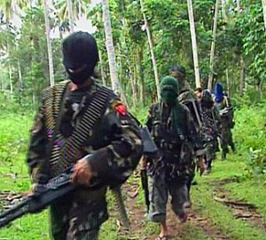 A report in the Philippine Daily Inquirer cited a report to officials including Executive Secretary Paquito Ochoa Jr. indicating Filipinos are among the Southeast Asians being lured to conflict zones in the Middle East. Some Islamic militants are home-grown, just like the Abu Sayyaf (in photo), who have links with al-Qaeda terrorists. (Photo from http://vkb.isvg.org/Wiki/Groups/Abu_Sayyaf_Group_(ASG))