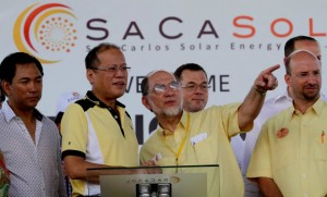 "President Benigno S. Aquino III, assisted by SACASOL's chairman Jose Maria ""Jomari"" Zabaleta and president Jose Maria ""Sech"" Zabaleta, Jr., leads the Ceremonial Switch-on of the San Carlos Solar Energy, Inc in San Carlos City, Negros Occidental last May 15 as lawmakers mull a bill mandating the installation of solar panels in public schools in isolated places in the country without electricity to improve the learning capabilities of students in the areas."