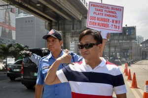Metropolitan Manila Development Authority (MMDA) Chairman Francis Tolentino (right) personally oversees on Tuesday the implementation of the odd-even scheme for provincial buses plying the stretch of EDSA. The buses will be allowed in tunnels along EDSA until January. (MNS photo)