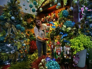 A staff member of the Natural Art Flower and Decors shop in Tayuman, Manila, arranges items at the shop's Christmas decors and toys store on Saturday November 8, 2014.(MNS photo)
