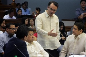 Senator Teofisto Guingona III (right), chair of the Senate Blue Ribbon committee, listens as subcommittee members Senators Antonio Trillanes IV, Aquilino Pimentel III, and Alan Peter Cayetano discuss the measures to be taken after Vice President Jejomar Binay did not show up at the Senate probe on the alleged overpriced Makati City Hall Building II on Thursday, November 6. Binay is in Cebu for several meetings. (MNS photo)