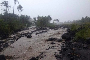 Mud flow from Mayon Volcano is seen rushing through a tributary in Bgy. Maipon in Guinobatan, Albay as rain brought about by typhoon Ruby hits the province on Sunday. Ruby is expected to pass near the province after making landfall in Eastern Samar on Sunday. (MNS photo)