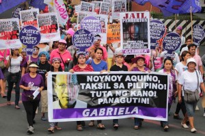 """Members of the militant womens group Gabriela marched to Mendiola Tuesday to condemn the Aquino government for having no support to the slain transgender Jennifer Laude. The group acuse the President as """"Tuta"""" of the US Government. Photo by: R.M."""