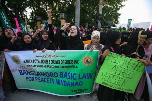 Muslim women from several organizations in Metro Manila rally outside the Senate on Monday, January 26, to call for the immediate passage of the Bangsamoro Basic Law. Senator Ferdinand Marcos Jr. on Monday said he is calling for the suspension of hearings on the BBL following the deaths of at least 37 policemen in an ambush on January 25 in Mamasapano, Maguindanao by MILF fighters. (MNS photo)
