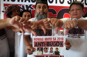 "Representatives from different Muslim groups gesture a thumbs-down sign as they launch their ""Anti-Bugok (rotten) Coalition"" urging the public not to vote for pro-war politicians, at a press conference in Manila, Monday. The groups criticized several politicians calling for all-out war against Moro rebels in Mindanao in response to the bloody Mamasapano encounter.(MNS photo)"