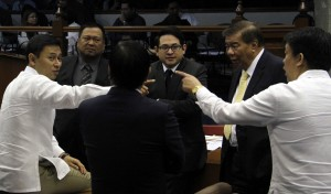 Senators Juan Edgardo Angara (left) and Aquilino Pimentel III (extreme right) exchange views before the Senate passage on third and final reading of the bill postponing the Sangguniang Kabataan (SK) elections from Feb. 21, 2015 to the last Monday of October 2016. Also in photo are Senate President Franklin Drilon and Senators Joseph Victor Ejercito and Paolo Benigno Aquino IV. (MNS photo)