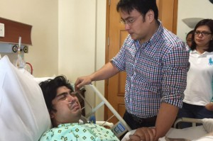 Senator Bong Revilla (center) consoles his son, Cavite Vice Governor Jolo Revilla, at the Asian Hospital on Tuesday. The elder Revilla was allowed by the court to visit his son who sustained a gunshot wound on Saturday. Also in the picture is Sen. Revilla's wife, Cavite Rep. Lani Mercado (right).(MNS photo)