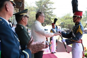 President Benigno S. Aquino III, assisted by PMA Superintendent Lt. Gen. Oscar Lopez; PMA Commandant of Cadets BGen. Rozzano Briguez; and PMA Academic Group head Col. Joseph Villanueva, presents the Presidential Saber Award and diploma to Cadet First Class Arwi Martinez for topping the Sundalong Isinilang na may Angking Galing at Lakas, Handang Ipaglaban ang Bayan (Sinaglahi) Class of 2015 during the 110th Commencement Exercises of Philippine Military Academy (PMA) at the Fajardo Grandstand, Borromeo Field, Fort General Gregorio del Pilar in Baguio City on Sunday (March 15, 2015). The PMA boast of a long and illustrious history of preparing only the best Filipino men and women for military service. (MNS photo)