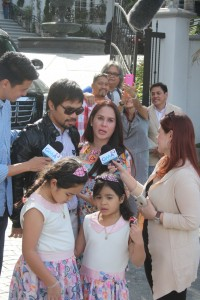 Boxing Pays: Jinkee Pacquiao, wife of boxing champion Manny Pacquiao, appreciates the champ's gift of a house in the famed Beverly Hills area shown to her shortly after her arrival in Los Angeles. The Pacquiao's are expected to move in their new abode by the first week of April. Realtor Nick Enciso,(extreme right in the background)  from Century 21 Classic Estates in Cerritos brokered for the mansion once owned by a celebrity.