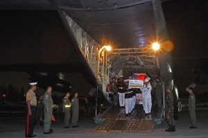 Filipino servicemen accord a low-key arrival honor at the Villamor Air Base on Friday for two Marines who were killed in intensified operations against the Bangsamoro Islamic Freedom Fighters (BIFF) in Maguindanao. The BIFF is believed to be protecting terrorist Basit Usman, who escaped the Mamasapano operation. (MNS photo)