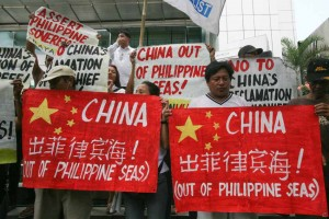 Members of Bayan Muna hold a picket in front of Chinese consulate in Makati on Friday April 17 to protest against China's reclamation activities in Panganiban Reef, part of the disputed areas in the West Philippine Sea. Recent satellite pictures showed the Chinese constructing facilities in the area. (MNS Photo)