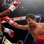 Pacquiao falls short, Mayweather still undefeated