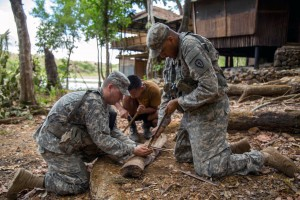 U.S. soldiers try to start a fire with bamboo sticks during a jungle training exercise in Fort Magsaysay, Philippines, April 17, 2015. U.S. Army photo by Pfc. Samantha Van Winkle