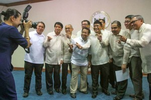 Senator Grace Poe (left) reverses roles with news photographers, taking the picture of newly elected Press Photographers of the Philippines officers shortly after their oath taking Monday at the Senate. Poe led the oath taking as chairman of the Committee for Public Information and Mass Media. (MNS Photo)
