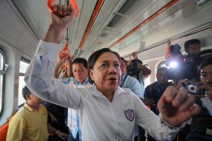 Senator Cynthia Villar, principal sponsor of the law extending the corporate life of Philippine National Railways (PNR) to another 50 years, rides the train during an inspection on Friday. The PNR will reopen the line from Tutuban to Sta. Rosa, Laguna after a mishap in April suspended operations. (MNS Photo)