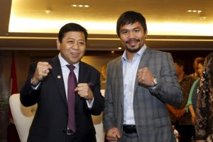 Filipino boxing champion Manny Pacquiao (right) poses with the head of Indonesia's House of Representatives (DPR) Setya Novanto during a courtesy call in Jakarta, Indonesia on Friday. Pacquiao earlier visited convicted Filipino drug mule Mary Jane Veloso at an Indonesian prison. (MNS photo)
