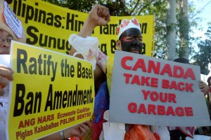 Environmentalists stage a protest at the foot of Mendiola bridge in Manila on Monday, May 4, as a send-off to President Aquino on his visit to Canada later this week. The group called on Aquino to demand that the Canadian government take back their illegal waste which has been languishing in the port of Manila.  (MNS photo)