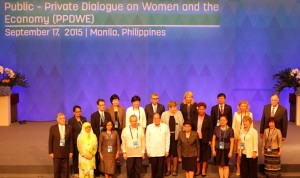 """President Benigno S. Aquino III, accompanied by Trade and Industry Secretary Gregory Domingo, shares the stage with the PPDWE heads of delegation for a group photo during the Asia-Pacific Economic Cooperation (APEC) Women and the Economy 2015 Fora Public Private Dialogue on Women and the Economy (PPDWE) at the Reception Hall of the Philippine International Convention Center (PICC) in Pasay City on Thursday (September 17), with the theme: """"Women as Prime Movers of Inclusive Growth."""" The Fora supports the Policy Partnership on Women and the Economy by gathering more participation from multi-sector key players from the private sector, academia, and civil society for dialogue and exchange of learning and best endeavors to advance gender integration, gender equality and women's economic empowerment agenda in APEC. (MNS photo)"""