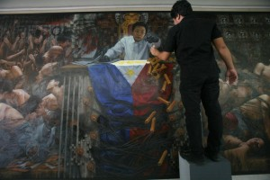 "-- Artist Randalf Dilla polishes his 8 x18.5 feet oil and acrylic painting ""Salvage Memories, Salvage Lives"" at Hiraya Gallery in Manila, Friday. The masterpiece, which depicts human rights issues during the Martial Law era, will be exhibited in commemoration of its declaration on September 21.(MNS photo)"