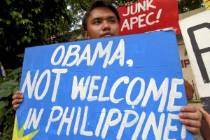 -- A student displays a placard protesting the scheduled arrival of US President Obama for the upcoming Asia Pacific Economic Cooperation meeting, in Manila on Thursday.  The Philippines will be hosting the 2015 APEC Economic Leader's meeting from November 17-20, wherein 21 world leaders are expected to attend.(MNS photo)
