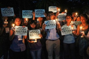 Environmental activists light candles at UP Diliman on Thursday, to commemorate the second year since Typhoon Yolanda hit the central Philippines on November 8, 2013.  The Category 5 super typhoon claimed the lives of more than 6,300 people and caused severe damage in Eastern Visayas.(MNS photo)