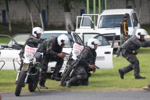 Members of the Quezon City Police District -Tactical Motorized Units hold a rehearsal on tactical convoy at Camp Karingal in Quezon City on Friday. The group is currently preparing for the upcoming APEC Summit on November 16-19 in Manila, where cops will be securing and escorting foreign delegates.(MNS photo)