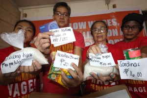 Members of the Confederation for Unity, Recognition and Advancement of Government Employees (COURAGE) show consumer goods equivalent to the proposed salary increase for government workers during a press conference on Thursday. The group raised concerns on the sufficiency of the proposed 45% increase under the Salary Standardization Law.(MNS photo)