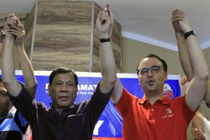 Rodrigo Duterte (left), seven-term Davao City mayor and presidential candidate, raises his hands with running mate Senator Alan Peter Cayetano during their proclamation ceremony in Manila on Monday. Duterte filed his candidacy last week following weeks of speculation on his intention.(MNS photo)