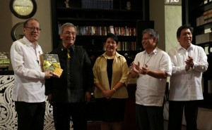 "President Benigno S. Aquino III receives a copy of the book entitled ""The Aquino Legacy: An Enduring Narrative"" from the authors Elfren Cruz and Neni St. Romana Cruz during the book launching at the Writers' Bar of the Raffles Hotel in One Raffles Drive, Makati Avenue, Makati City on Thursday (November 26). Also in photo are Education Secretary Armin Luistro and Communications Secretary Herminio Coloma. (MNS photo)"