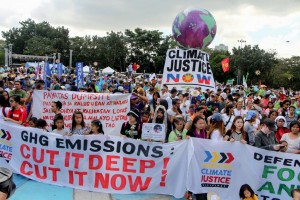 Thousands of environmental activists march in Quezon City on Saturday to air their messages to world leaders attending the Conference in Paris (COP) 21 World Climate Summit in Paris opening two days from now. The COP21 is organized by the United Nations Framework Convention on Climate Change.(MNS photo)