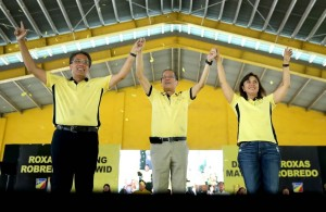 "Liberal Party (LP) chairman President Benigno S. Aquino III raises the hands of LP Presidential Candidate former DILG Secretary Manuel ""Mar"" Roxas II and LP Vice Presidential Candidate Camarines Sur 3rd District Representative Maria Leonor ""Leni"" Robredo during the Meeting with Local Leaders and the Community at the PAG-ASA Gymnasium in Barangay F.E, Marcos, San Jose City, Nueva Ecija on Wednesday (February 24, 2016).(MNS photo)"